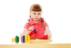 Beautiful little girl in a Montessori class Stock Photos
