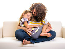 Beautiful little girl and mother cuddling Royalty Free Stock Photography