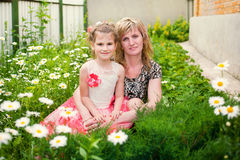 Beautiful little girl with mother outdoor Stock Photo