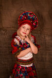 Beautiful little girl in national costume. Dancing Stock Photography