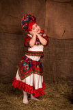 Beautiful little girl in national costume. Dancing Royalty Free Stock Photography