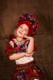 Beautiful little girl in national costume. Dancing Stock Image