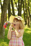 Beautiful little girl on nature with a bouquet of flowers Royalty Free Stock Photos