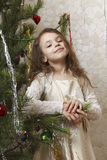 Beautiful girl near the Christmas tree. Royalty Free Stock Images