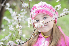 Beautiful little girl near a flowering tree Royalty Free Stock Photos