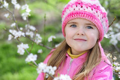 Beautiful little girl near a flowering tree Stock Photography