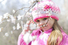 Beautiful little girl near a flowering tree Stock Images