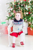 Beautiful little girl next to Christmas decorated tree Royalty Free Stock Images