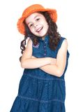 Beautiful little girl in an orange hat Stock Images