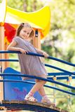 Beautiful little girl on outdoor playground Stock Photography