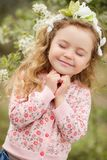 The beautiful little girl with bush blossoming tree royalty free stock photo
