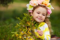 The beautiful little girl with bush blossoming tree stock images