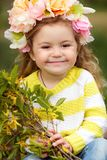 The beautiful little girl with bush blossoming tree royalty free stock photos