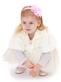 Beautiful little girl outfit on a white dress Stock Photo