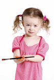 Beautiful little girl with paintbrush Stock Photography