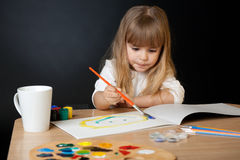 Beautiful Little Girl Painting Royalty Free Stock Photos