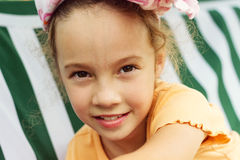 Beautiful little girl in the park close up Stock Photo
