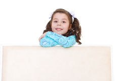Beautiful little girl peeking out from behind. Kids,girl,kid,child- beautiful little girl peeking out from behind. Isolated on white background Royalty Free Stock Photography