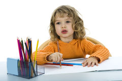 Beautiful little girl with pencils Stock Photos