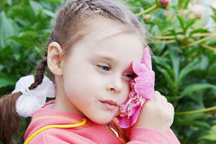 Beautiful Little Girl with Peony Flower Stock Photography