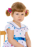 Beautiful little girl with pigtails charming. Stock Photography