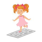 Beautiful little girl in a pink dress playing hopscotch, colorful character vector Illustration. On a white background Royalty Free Stock Photo