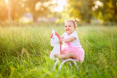 Little girl on a toy horse Royalty Free Stock Image