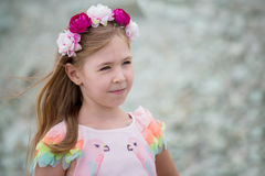 Beautiful little girl with pink flower wreath on hair Stock Photography