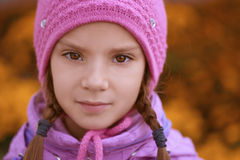 Beautiful little girl in pink hat Stock Images