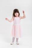 Beautiful little girl in pink Princess dress on a gray backgroun Stock Photo