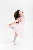 Beautiful little girl in pink Princess dress jumps for joy on a Stock Photos