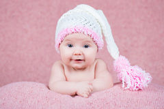Beautiful little girl in pink warm headphones Royalty Free Stock Photo