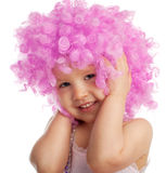Beautiful little girl in pink wig Stock Photo