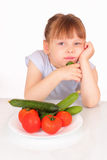 Beautiful little girl with plate with vegetables Stock Image
