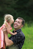 Beautiful little girl play with dad Stock Images
