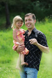 Beautiful little girl play with dad Royalty Free Stock Photography