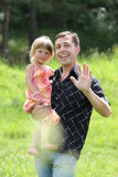 Beautiful little girl play with dad. In nature royalty free stock images
