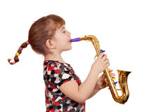 Little girl play music on saxophone Stock Image