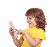 Beautiful little girl play with tablet pc Royalty Free Stock Photo