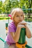 Beautiful little girl on playground Royalty Free Stock Image