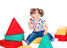 Beautiful little girl playing in the constructor Stock Photos