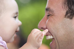 Beautiful Little Girl Playing With Dad Stock Photo