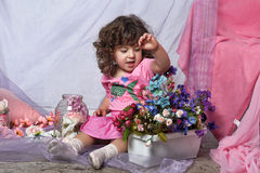 Beautiful little girl  playing with flowers Royalty Free Stock Photos