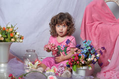 Beautiful little girl  playing with flowers Stock Photo