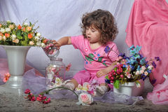 Beautiful little girl  playing with flowers Stock Photos