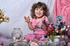 Beautiful little girl  playing with flowers Stock Images