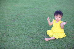 Beautiful little girl playing with grass Royalty Free Stock Photos