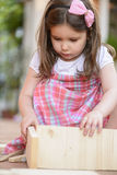 Beautiful little girl playing outdoor Royalty Free Stock Image