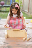 Beautiful little girl playing outdoor Royalty Free Stock Photo