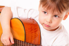 Beautiful little girl plays guitar Stock Photo